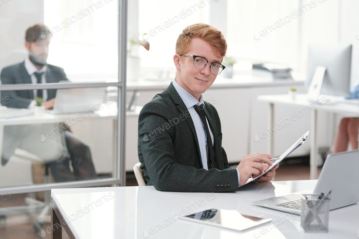 Cheerful Young Entrepreneur at Workplace