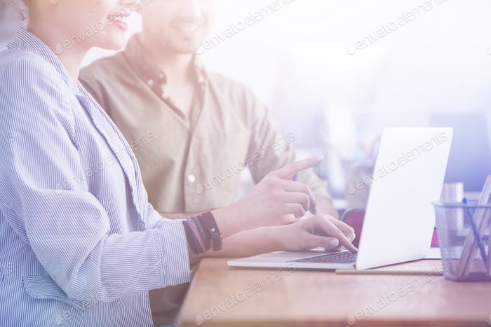 Lady pointing at laptop screen
