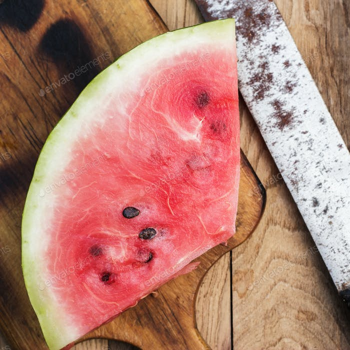 Watermelon And Old Knife On The Table
