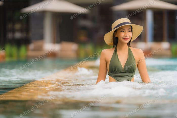 Portrait beautiful young asian woman relax in luxury outdoor swi
