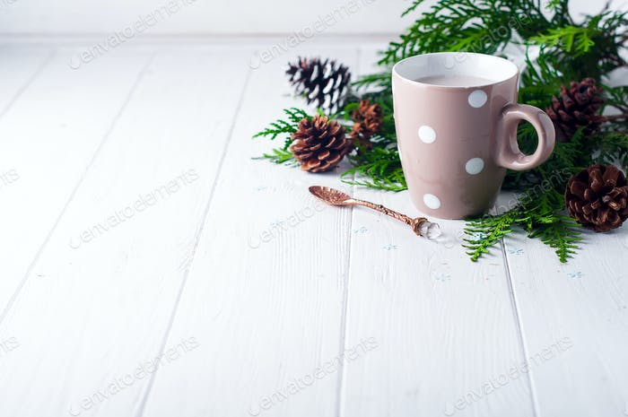 vintage Cup of hot cocoa on wooden background decorated with spruce and pine cones,
