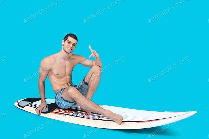 Cheerful surfer in studio