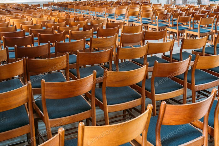 Many Empty Wooden Chairs With Backrest, Blue Upholstery Standing