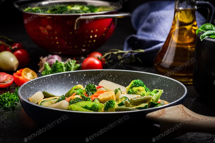 Thumbnail for Stir Fry Fresh Vegetables Mix on Frying Pan. Dark Tones Black Image. Healthy Eating Ideas