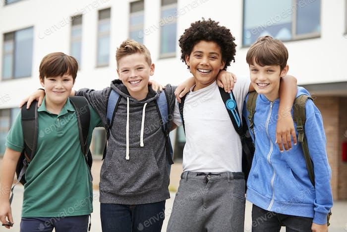 Portrait Of Male High School Student Friends Standing Outside School Buildings