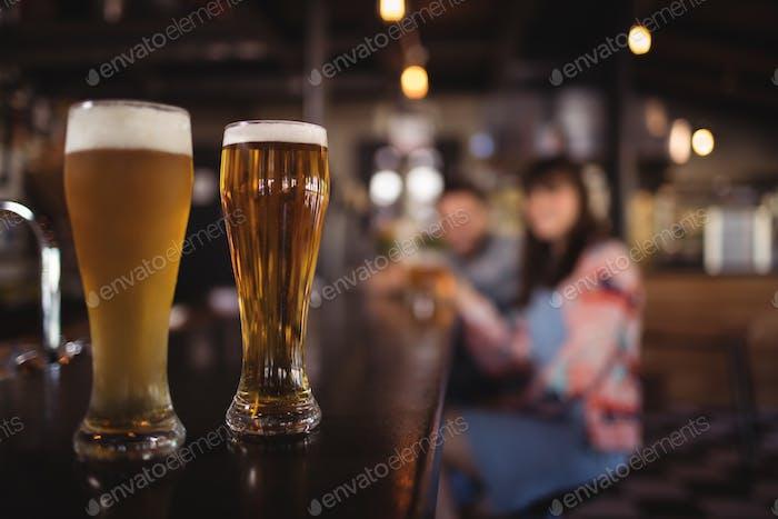 Two beer glasses on worktop