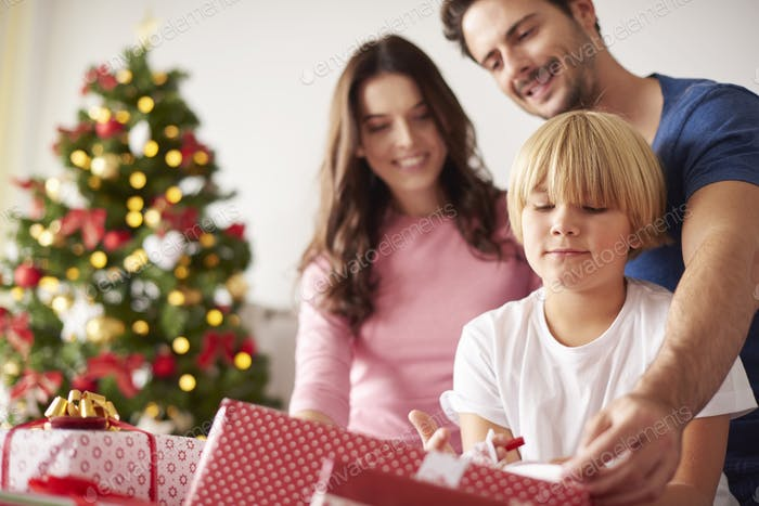 Family starting Christmas from opening presents
