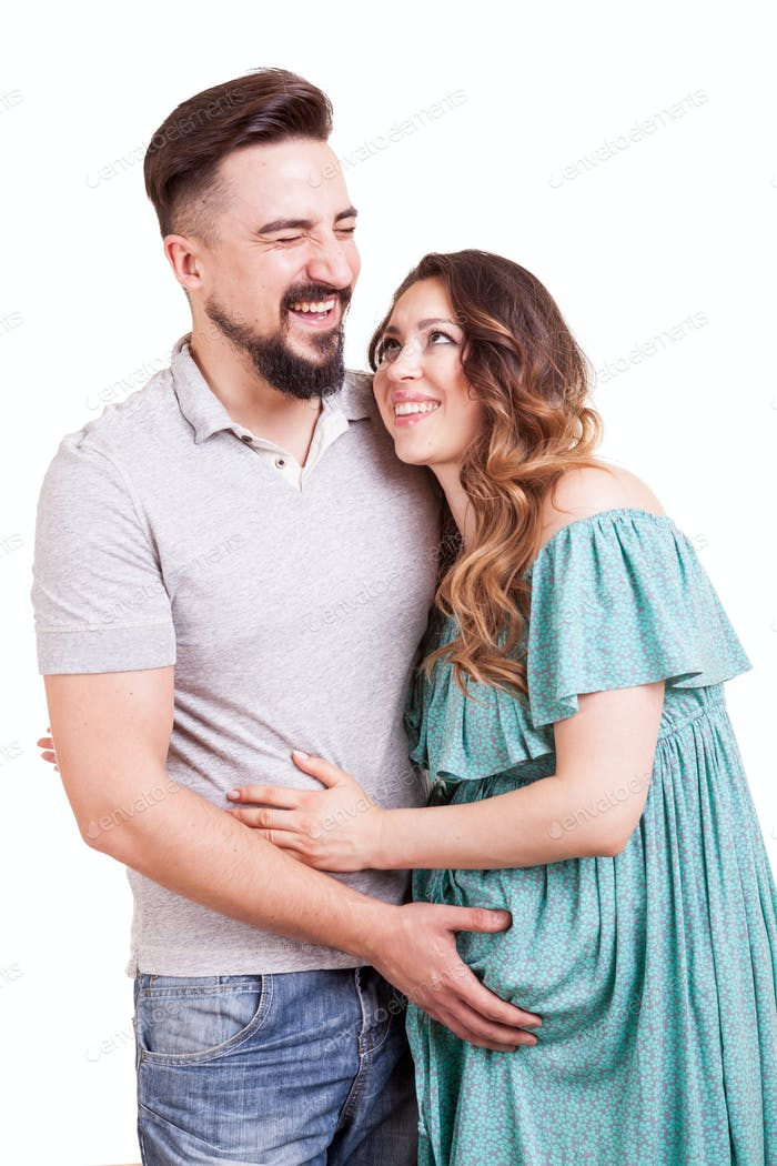 Pregnant woman with her husband in studio photo on white backgro