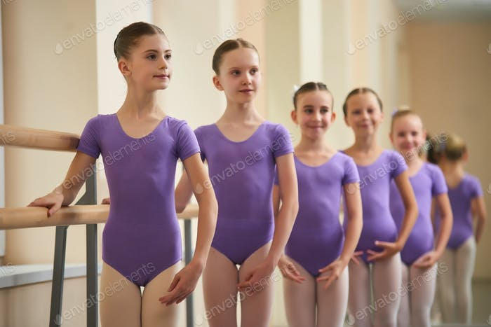 Young ballerinas standing in position.