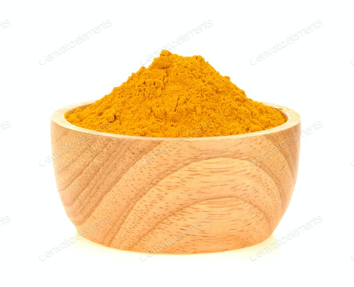 Turmeric powder in a wooden bowl on white background.