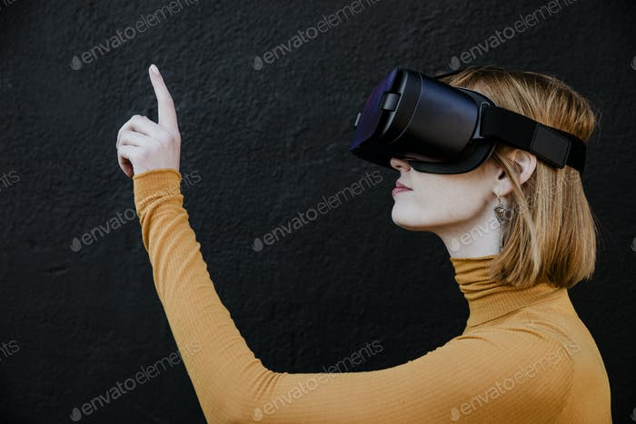 Woman tapping on a VR command