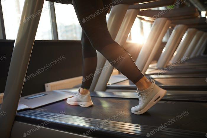 Female Legs Running on Treadmill