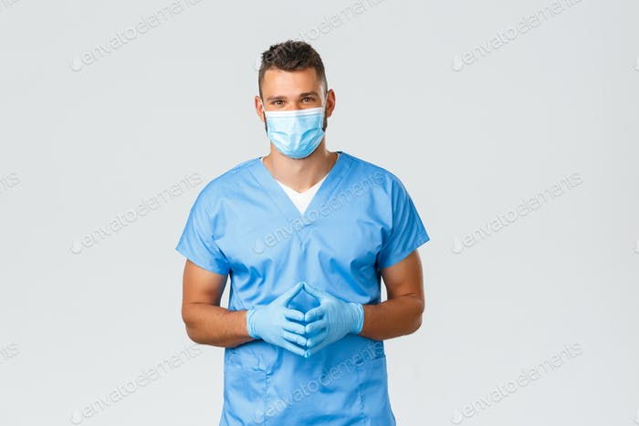 Healthcare workers, covid-19, coronavirus and preventing virus concept. Friendly handsome doctor
