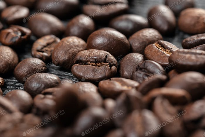 Coffee beans on wood background. close up. creative photo