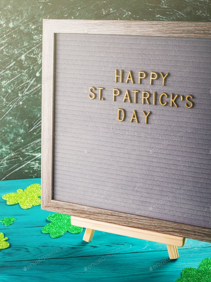St Patrick Day greetings on letter board, shamrock