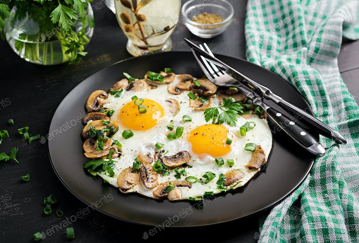Fried egg, mushrooms and spinach. Keto, paleo breakfast.