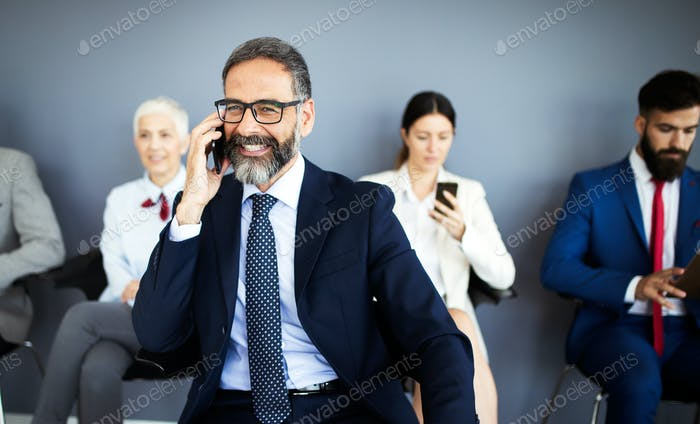 Senior business people using mobile phone. Telecommunication technology and internet of things