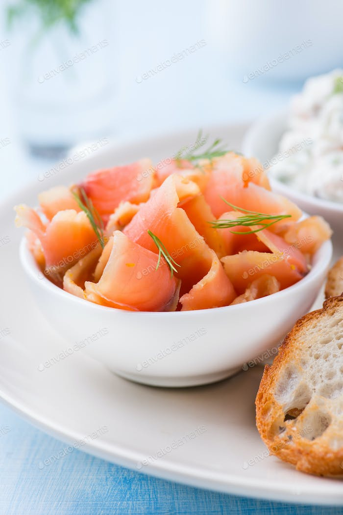 Smoked wild salmon and baguette on plate