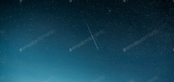Night Starry Sky With Glowing Stars And Meteoric Track Trail. Me