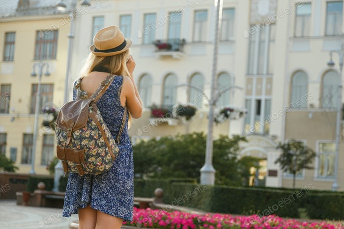 Woman traveler making a photo