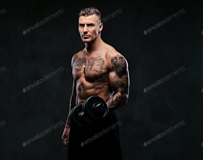 A muscular man doing exercises with dumbbells.