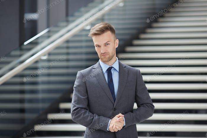 Serious handsome businessman