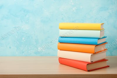 Education concept with stack of books on wooden table