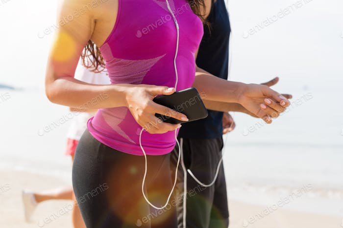 Group Of People Runners On Beach Closeup Of Young Sport Runners Jogging Together Working Out At