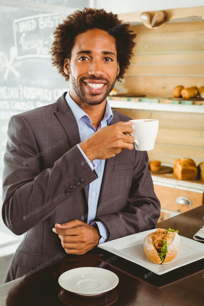 Businessman enjoying his lunch hour at the coffee shop