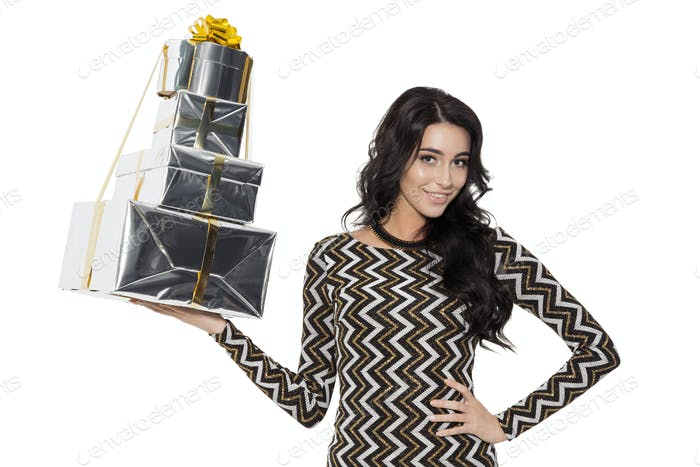Charming Woman Holding Gifts. Happy New Year. Merry Christmas.