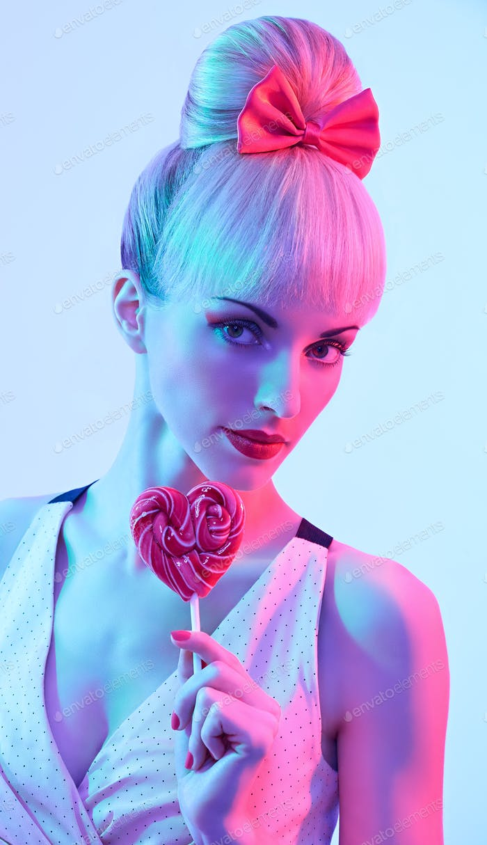 Fashion beauty portrait woman with lollipop, pinup