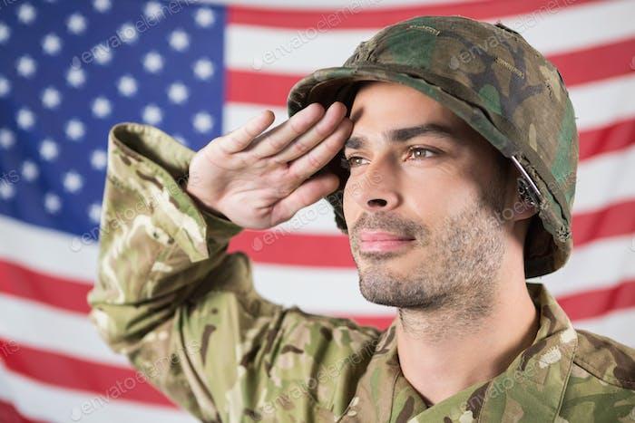 Confident soldier saluting