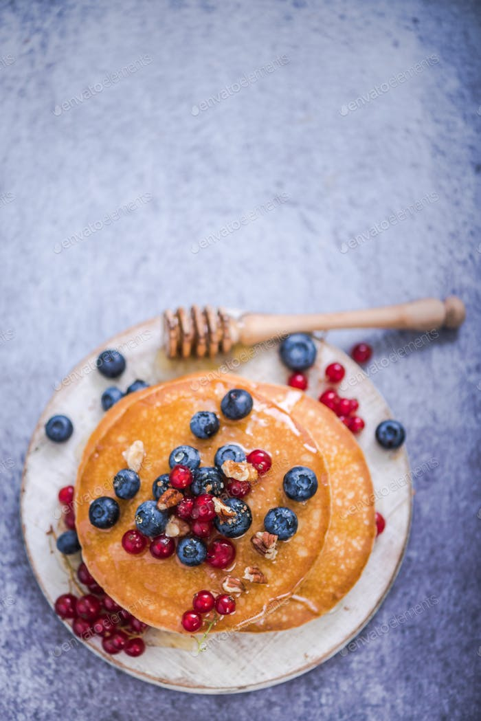 summer fruits on pancakes