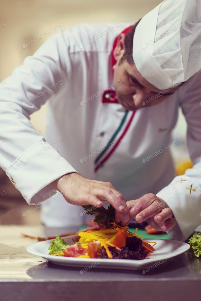 chef serving vegetable salad