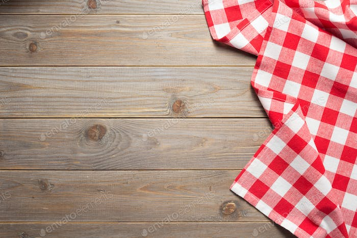 cloth napkin on at rustic wooden table background