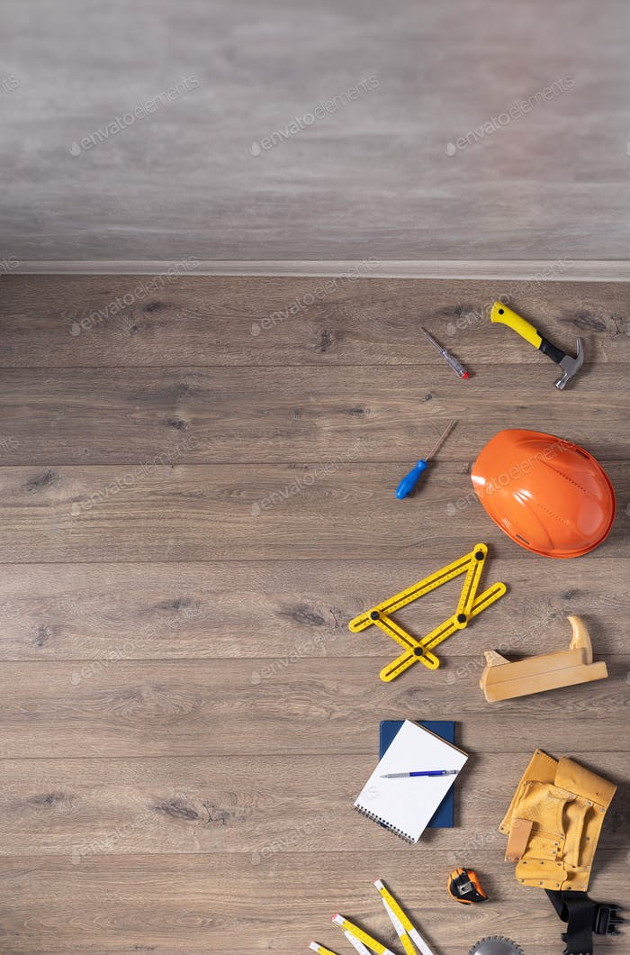 Laminate floor and tools at wood background texture. Wooden laminate floor plank