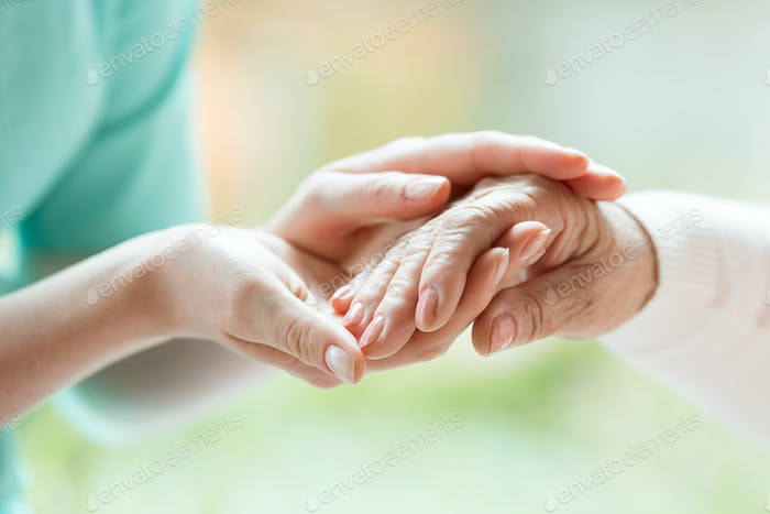 Senior person thanking the nurse
