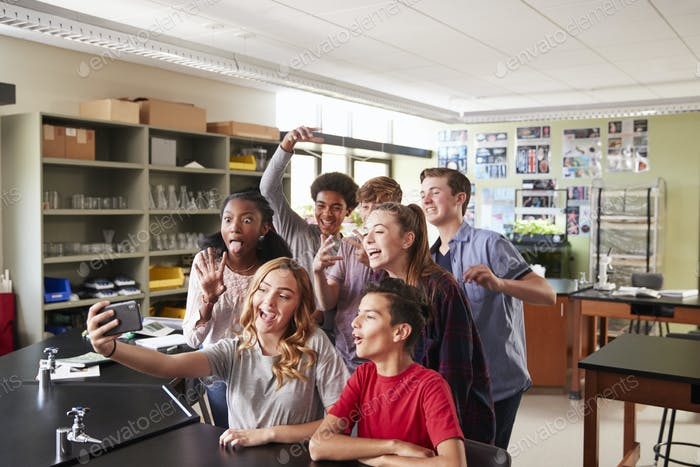 Group Of High School Students Taking Selfie In Biology Classroom