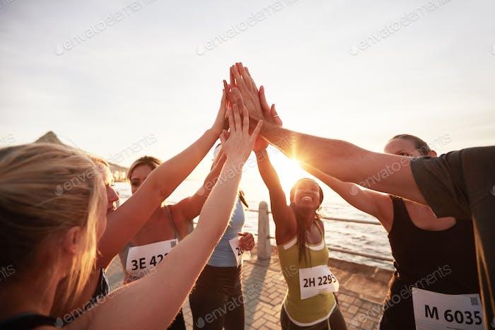 Marathon runners giving high five