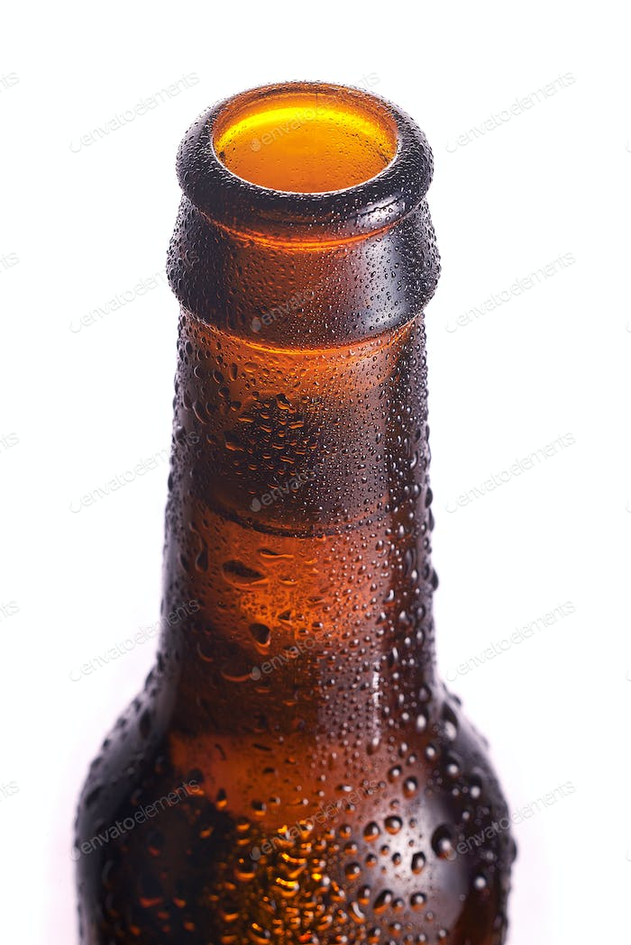 Detail of the bottleneck on a brown bottle with condensation around it