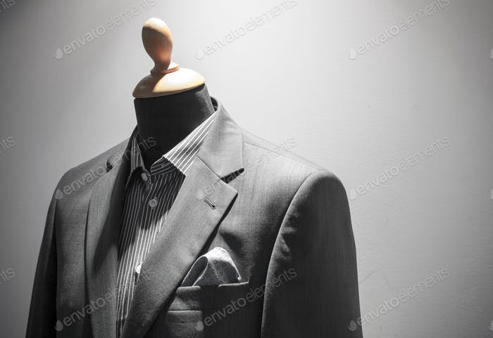 Elegant men suit on mannequin, shopwindow