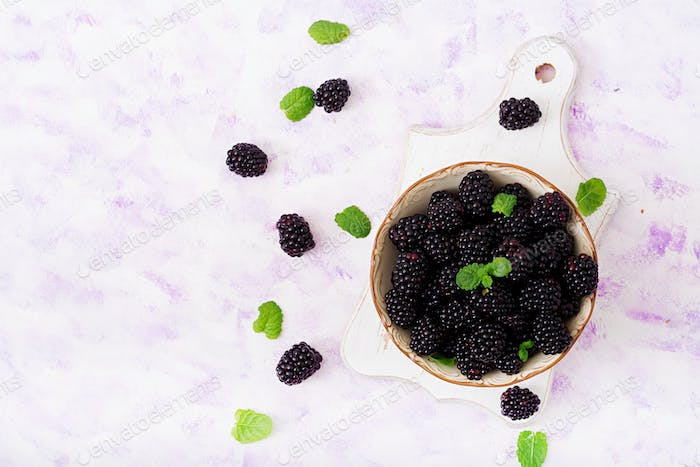 Thumbnail for Summer berry on table. Healthy lifestyle concept, blackberries in bowl. Flat lay. Top view