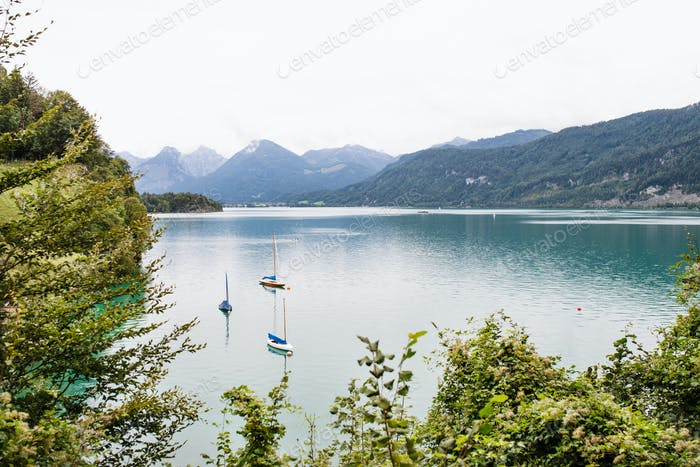 Boats on lake in the mountains, panoramic landscape.