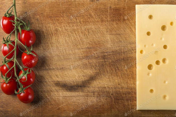 Emmental cheese with bunch of cherry tomatoes