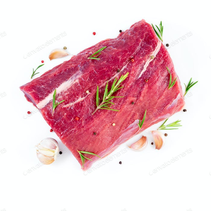 large piece of meat, raw beef fillet isolated on white background. Striploin with rosemary
