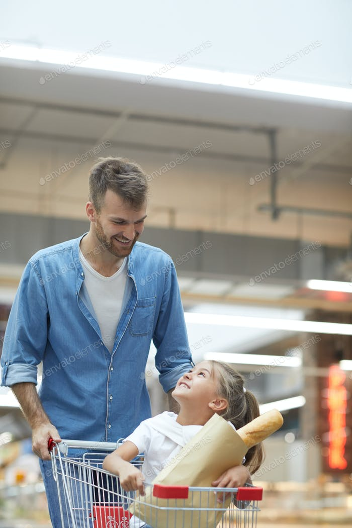Happy Father Shopping in Supermarket