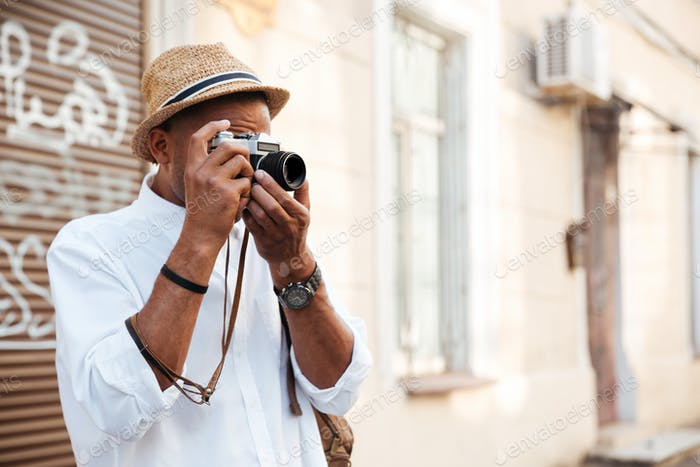 Afro american man making photo