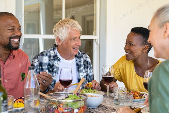 Mature friends enjoying lunch together