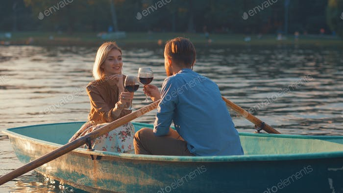 Happy young couple in a boat