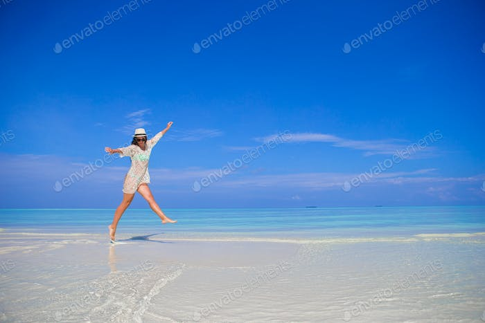 Young woman enjoy tropical beach vacation on Maldives